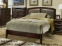 Queen Size Panel Bed With Gray Upholstered Headboard In Dark Merlot Finish